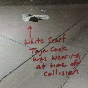Taja Cook's white scarf